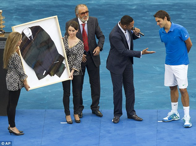 Hollywood memorabilia: Will Smith gave Roger Federer a framed black suit today from Smith's last movie Men in Black 3 after Federer won the Madrid Open