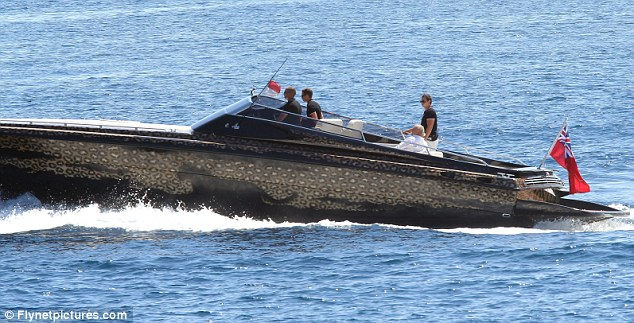 On the prowl: The Topshop mogul's runabout boat 'Lion cub', which ferries him to his super yacht 'Lion heart', is covered in leopard print and features a leopard on the side