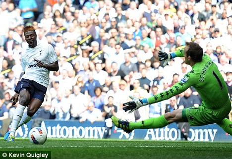 Easy does it: Adebayor opened the scoring for Tottenham after two minutes
