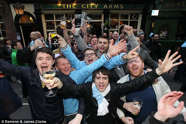 After party: Fans head to 'The City Arms' pub in Manchester City centre to celebrate their side's monumental win