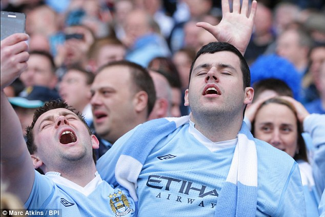 Elation: Manchester City fans cannot hide their relief and elation as a last gasp winner secures the league title for their club