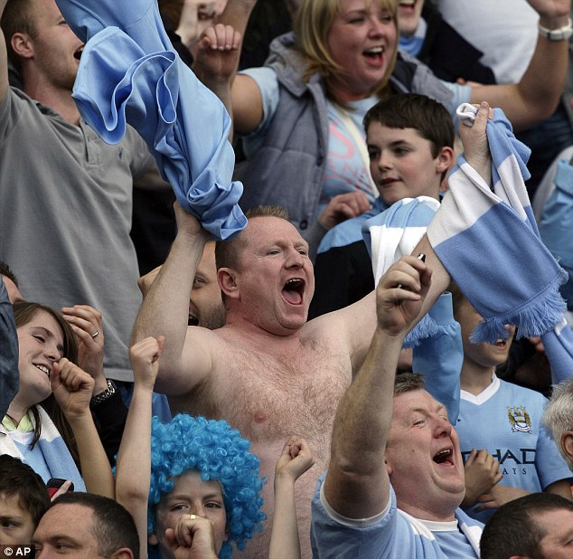 Ecstasy: One fan whips off his shirt to celebrate his team's incredible win
