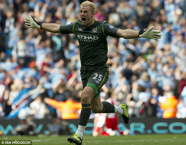 No more Hart ache: England No 1 Joe Hart is ecstatic after Aguero's goal brought an end to 44 years without a championship at City