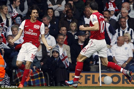 Three and easy: Van Persie toasts Benayoun's opening goal as Arsenal secured third place