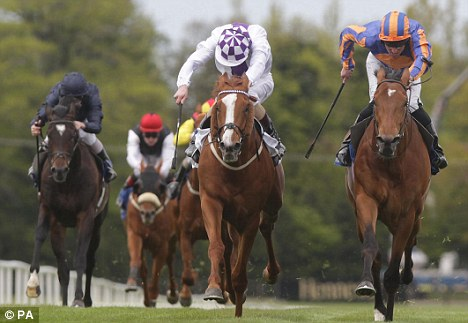 Knockout blow: Kevin Manning (left) have Light Heavy a great ride to win at Leopardstown