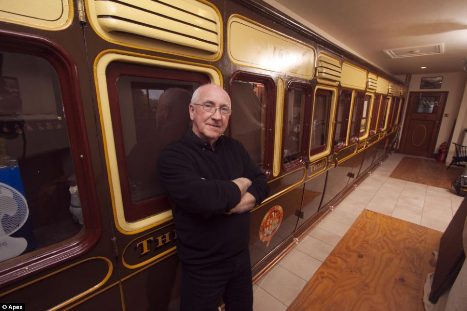 House trained: Bizarre planning regulations meant that Mr Higgins' former father-in-law had to build the bungalow around the railway carriage as it could not be moved