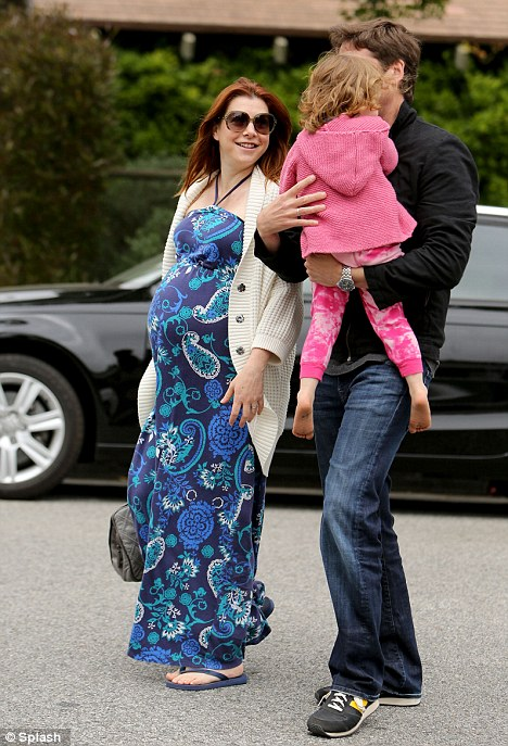Family day: Actress Alyson Hannigan enjoyed a visit to a park with her husband and daughter on Saturday in Los Angeles