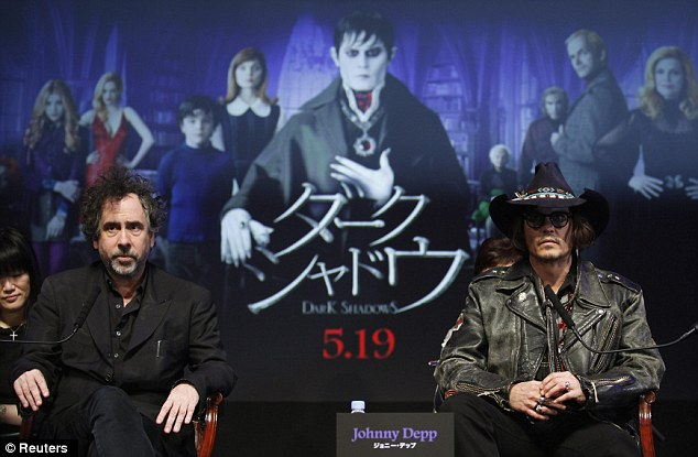 Regaining his composure: Burton and Depp were seated as they prepared for questions from the Press