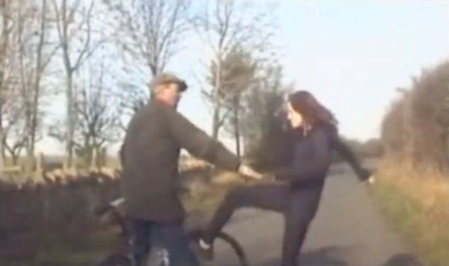 Confrontation: The angry woman can be seen raising her leg to kick the cyclist during the YouTube clip