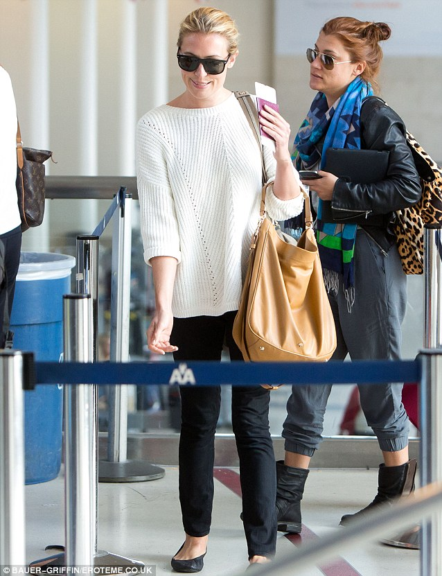 Didn't hide it for long: Cat (pictured at LAX yesterday) went on a romantic holiday to Mexico with Patrick in February