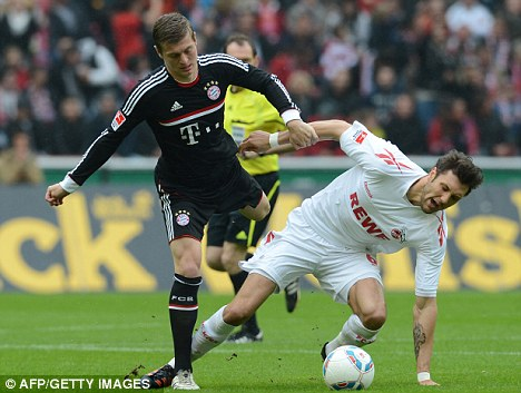 Midfield maestro: Toni Kroos (left) has emerged as one to watch