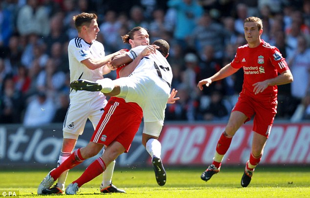 Tussle: Carroll and Williams grapple