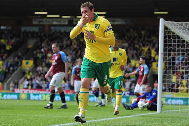 Early bird: The Canaries scored quickly thanks to Holt and never looked back