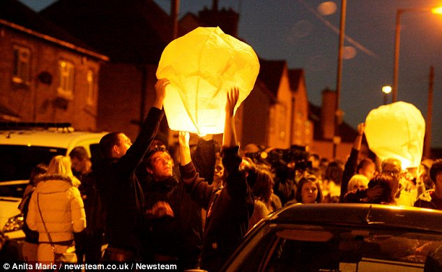 Vigil: Members of the Allenton community laid flowers and released Chinese lanterns into the night sky in tribute to the five children that died