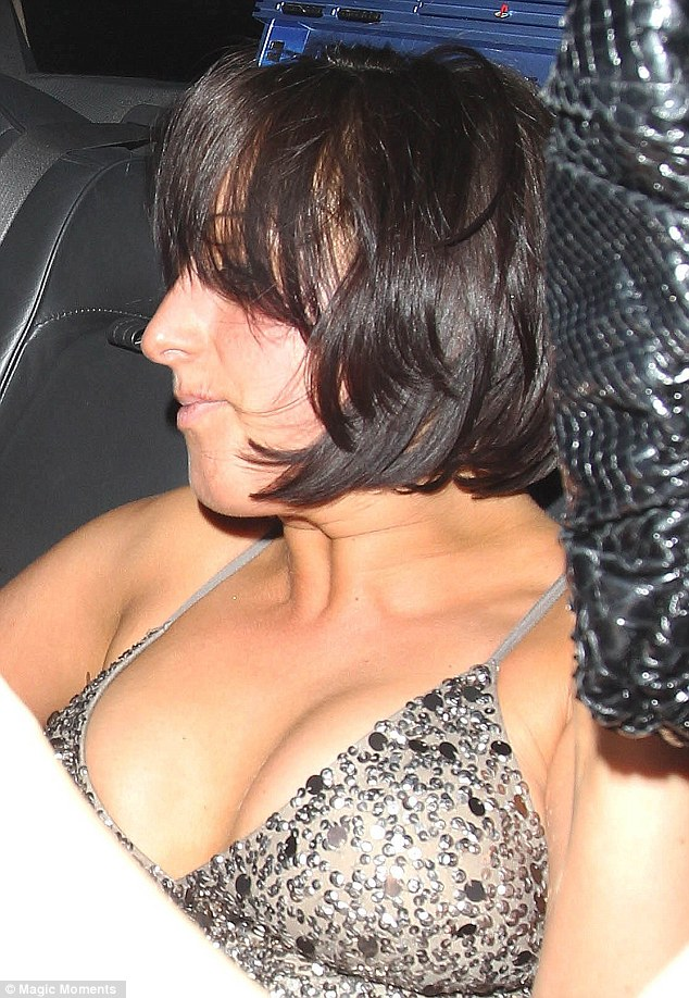 Home bound: Natalie appeared to be ready for bed as she sat in the white limo