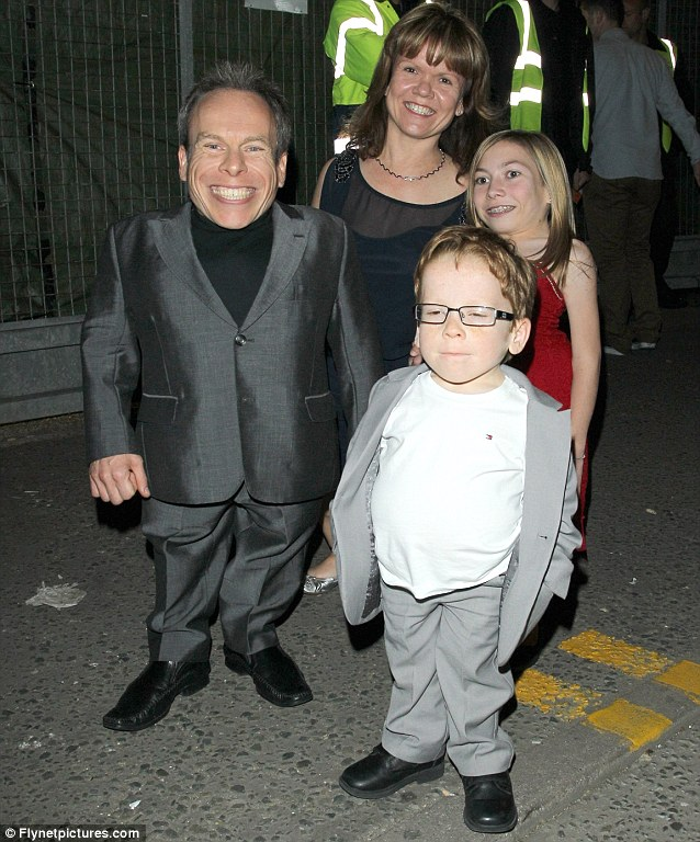 Showed up to celebrate: Warwick Davis, his wife Samantha and their two children Annabel and Harrison all looked pleased with the night's result