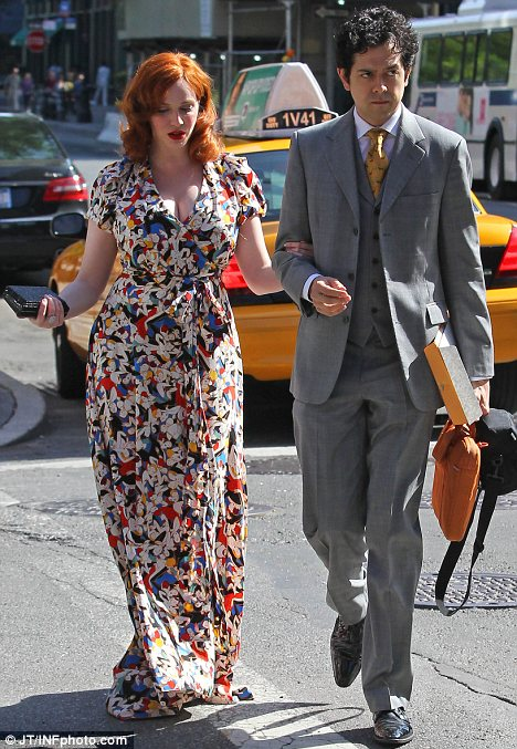 Swinging Sixties: Christina Hendricks looked like she had stepped off the Mad Men set when she made her way to a wedding with Geoffrey Arend