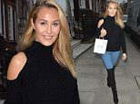 NON EXCLUSIVE PICTURE: MATRIXPICTURES.CO.UK PLEASE CREDIT ALL USES WORLD RIGHTS English reality television personality Chloe Goodman is pictured as she visits the Court House Clinic, in London, where she gets a cosmetic procedure performed on her lips.  The blonde star, who looks chic wearing a black jumper paired with blue jeans and knee high boots, wears a large pair of sunglasses as she leaves the clinic with a much larger pout.  NOVEMBER 20th 2015 REF: LTN 153475