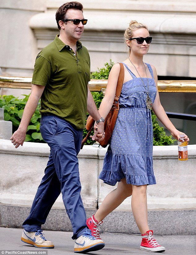 Getting handsy: Olivia and Jason looked adorable as they held hands during a Sunday stroll