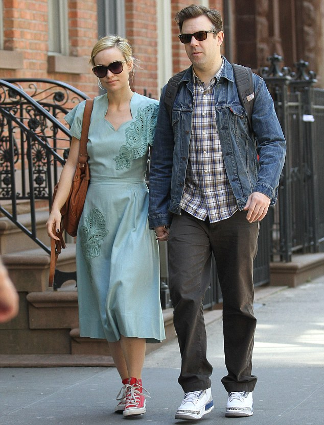 Bad pair: Olivia Wilde and boyfriend Jason Sudeikis were spotted out in New York yesterday, with the actress teaming her pretty green dress with a scruffy pair of Converse. Jason's trainers were also quite the eyesore
