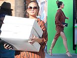 UK CLIENTS MUST CREDIT: AKM-GSI ONLY EXCLUSIVE: Model, Chrissy Teigen, showed she has no problem balancing herself in sky-high heels while pregnant and carrying 3 large pastry boxes.  The sexy star looked flawless in a stupid shirt dress she paired with 5 inch nude heels.  Regardless of her impressive balancing skills, her husband, John Legend, quickly jumped into action when he saw his pregnant wife coming around the corner with all the boxes and opened the door for her as she got close to the car.  Pictured: Chrissy Teigen and John Legend Ref: SPL1183246  221115   EXCLUSIVE Picture by: AKM-GSI / Splash News