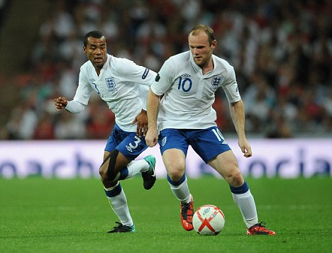 Cometh the hour: Wayne Rooney (right) is banned for the first two games