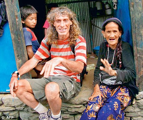 Bosusco Paolo poses with a native during during one of his tours outside Orissa