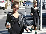 UK CLIENTS MUST CREDIT: AKM-GSI ONLY EXCLUSIVE: Los Angeles, CA - Supermodel Chrissy Teigen gets an early start on her day and visits her gym to keep up with her workout routine despite being pregnant with her first child. Chrissy sported an all black look to keep her tiny baby bump under wraps and rocked a cool rocker biker jacket.
