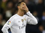 Real Madrid's Cristiano Ronaldo reacts next to Gareth Bale, right, as Barcelona's Luis Suarez celebrates with teammates after scoring his sideís fourth goal during the first clasico of the season between Real Madrid and Barcelona at the Santiago Bernabeu stadium in Madrid, Spain, Saturday, Nov. 21, 2015.  (AP Photo/Francisco Seco)