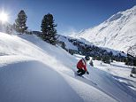 Skier sking at Hohe Mut in Obergurgl, Tyrol, Austria.   CTAB84 Skier sking in fresh new snow at hohen Mut, Obergurgl, Tyrol, Austria