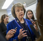 FILE - In this June 2, 2015, file photo, Sen. Dianne Feinstein, D-Calif., speaks with reporters on Capitol Hill in Washington. People on the U.S. government's terrorist watch list can't board commercial airliners, but they can walk into a gun store and legally buy pistols and powerful military-style rifles. The new Democratic push, which is considered unlikely to succeed in the GOP-controlled Congress, is focused on legislation by Feinstein that would let the attorney general compile a list of known and suspected terrorists.(AP Photo/Pablo Martinez Monsivais, File)