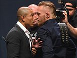 LAS VEGAS, NV - SEPTEMBER 04:  (L-R) UFC featherweight champion Jose Aldo and featherweight interim champion Conor McGregor face off during the UFC's Go Big launch event inside MGM Grand Garden Arena on September 4, 2015 in Las Vegas, Nevada.  (Photo by Josh Hedges/Zuffa LLC/Zuffa LLC via Getty Images)