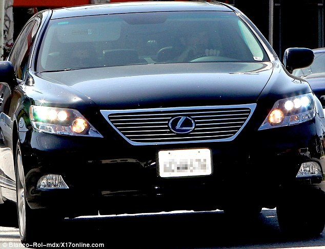 Secret meeting: Ashton was driving Rumer in his car, the pair are still close despite his split with her mother