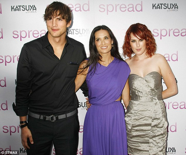 Ties that bind: Ashton with Demi and Rumer at the premiere of Spread in 2009
