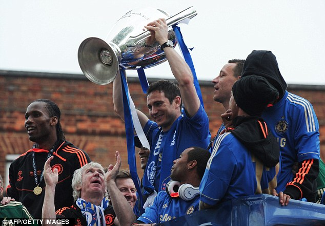 Finally getting his hands on the big one: Chelsea's Frank Lampard celebrates winning the Champions League after being part of the team that lost the final in 2008