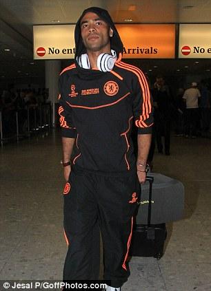 Back home: Ashley Cole arrives at Heathrow