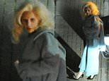 EXCLUSIVE PICTURE: MATRIXPICTURES.CO.UK PLEASE CREDIT ALL USES WORLD RIGHTS Lady Gaga is pictured arriving at London Heathrow Airport. The 29-year-old eccentric American singer wears a long pale blue outfit which exposes her toned stomach as she arrives in the early hours of Sunday morning. NOVEMBER 20th 2015 REF: LTN 153482