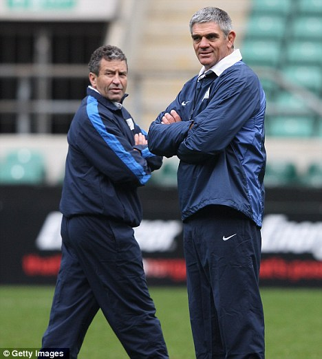 In the running: Mallett (seen here with Smith) could take the reins heading into the World Cup