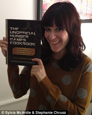 Emily Ansara Baines with her cookbook