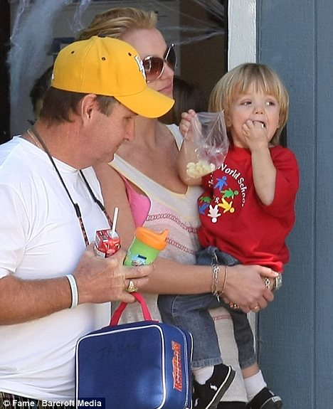 Daddy on duty: In 2008 Britney's father Jamie, seen with her here, took control of her estate as part of a conservatorship