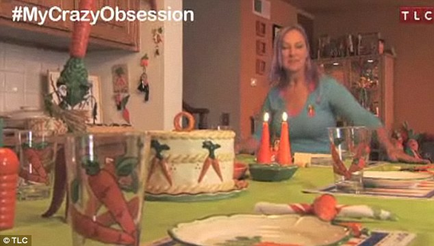 Tea for one: Even her table settings can't escape Ms Howell's obsession. She has carrot glasses, plates and candles