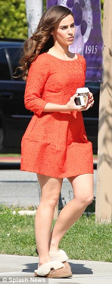 Coffee break: Jessica was snapped strolling round the set in between takes and then having her make-up touched up