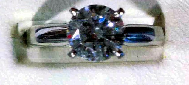 Expensive: This diamond ring worth £25,000 was also taken during the robbery
