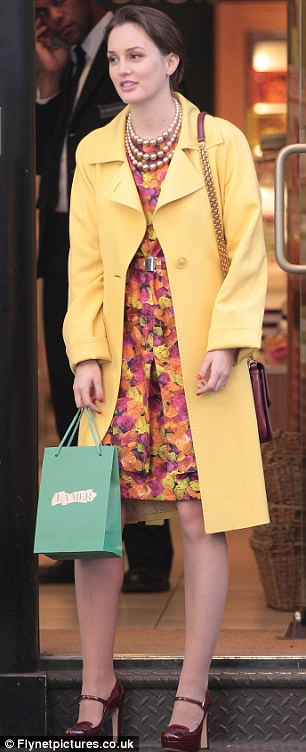 What would Blair say? Make-up free Leighton Meester looked a far-cry from her usual glamourous character of Blair Wardolf, right, as she stepped out on set in New York wearing a tracksuit, left