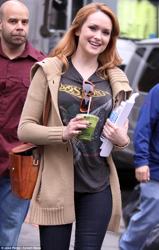 Keeping it simple: Her co-star Kaylee Defer was also casual in a rock T-shirt and pair of tight Indigo jeans