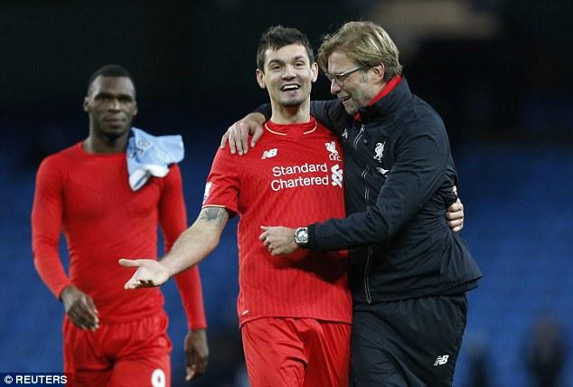 Liverpool defender Dejan Lovren embraces Jurgen Klopp following their 4-1 win over Manchester City