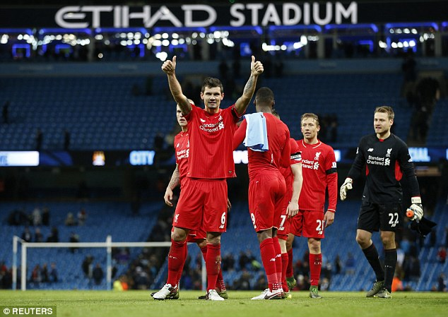 The Croatia centre back salutes the travelling Liverpool fans after securing victory at the Etihad Stadium