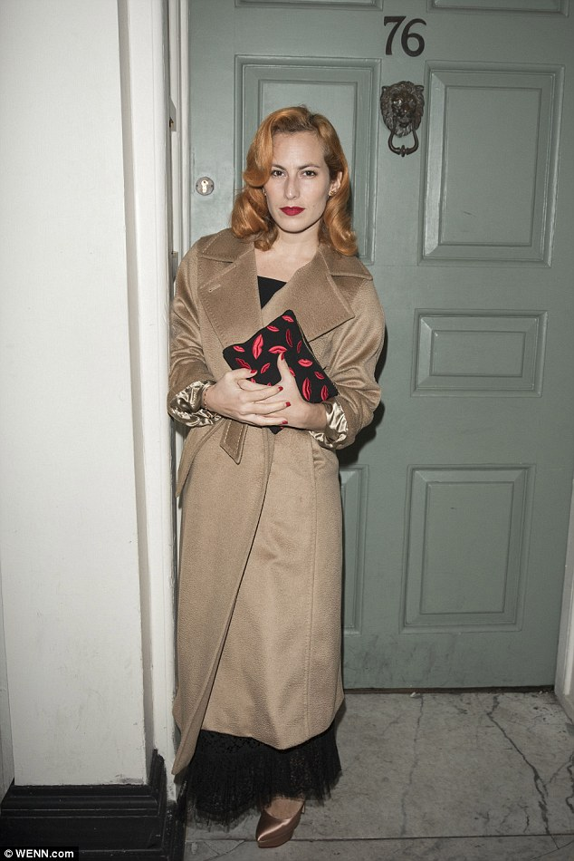 Stunner:Shoe designer Charlotte Olympia Dellal rocked her usual retro style in a wide-collar camel overcoat while her auburn locks were styled into 1950s style pin curls