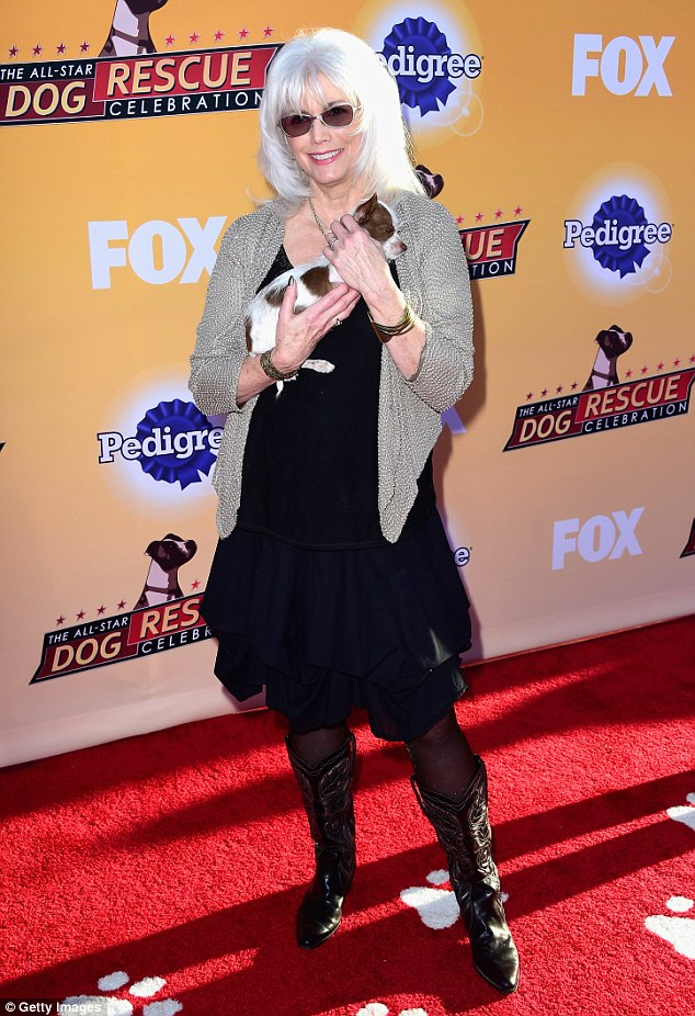 Something to sing about: Singer Emmylou Harris looked country chic in cowgirl boots at the event