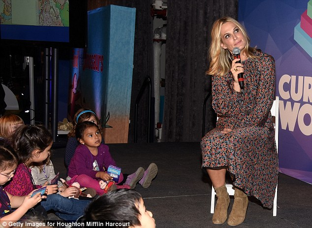 Striking speaker: The gorgeous mom-of-two wore a floral printed long sleeve dress and camel ankle boots